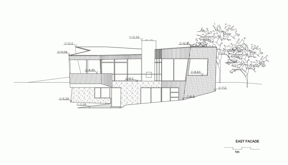 533b8660c07a807cd500007c_casa-dividida-jva_splithouse_east_facade-1000x572