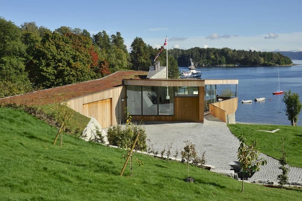 533b86e3c07a807cd5000082_casa-dividida-jva_splithouse_exterior_roofscape_03-1000x664