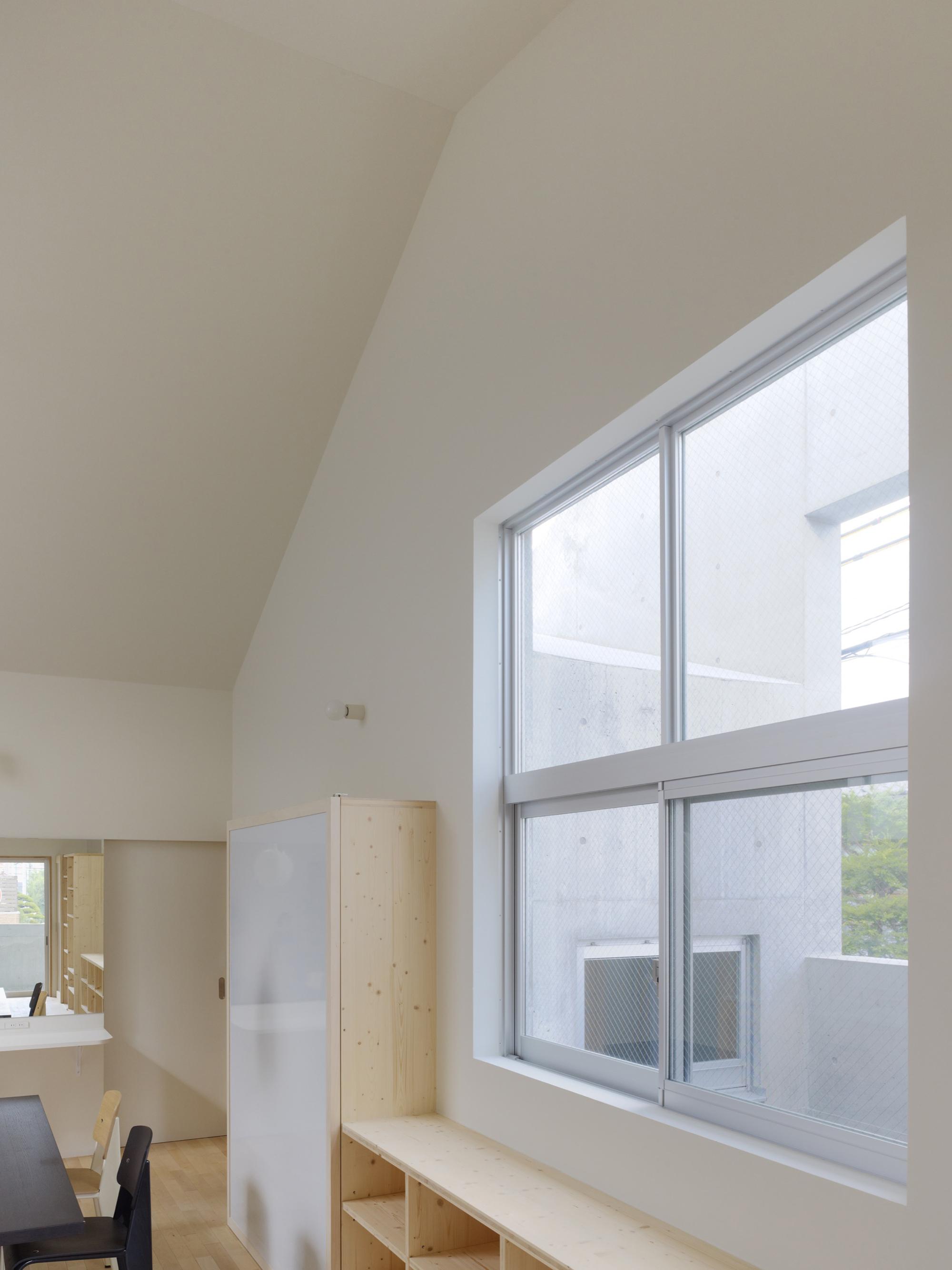 Casa en Kitaoji de Torafu Architects